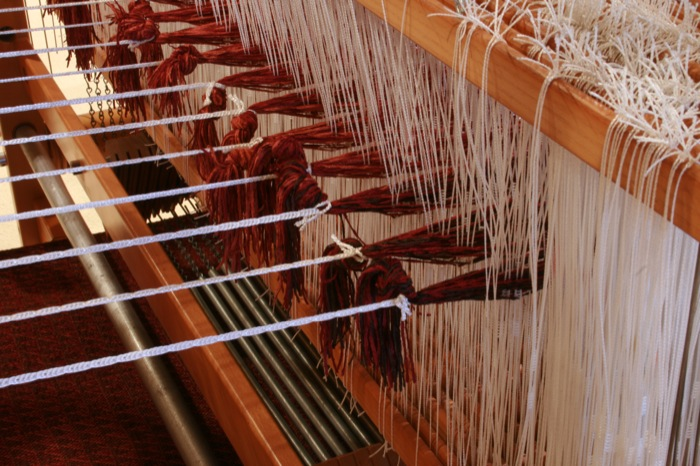 weaving rigup to the heddles